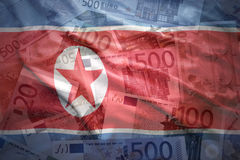 Colorful waving north korea flag on a euro  background Stock Photography