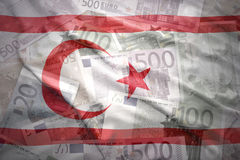 Colorful waving northern cyprus flag on a euro background Royalty Free Stock Photos