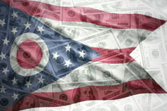 Colorful waving ohio state flag on a american dollar money background royalty free stock image