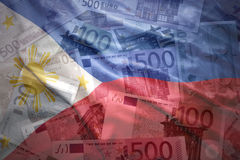 Colorful waving philippine flag on a euro background. Colorful waving philippine flag on a euro money background royalty free stock image