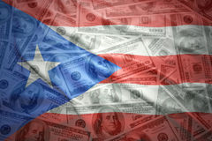 Colorful waving puerto rican flag on a dollar money background Stock Photos