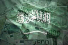 Colorful waving saudi arabia flag on a euro  background Royalty Free Stock Image