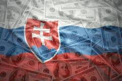 Colorful waving slovak flag on a dollar money background. Colorful waving slovak flag on a american dollar money background royalty free stock images