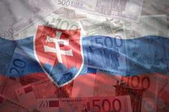Colorful waving slovak flag on a euro background. Colorful waving slovak flag on a euro money background stock photos