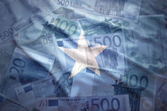 Colorful waving somalia flag on a euro  background. Colorful waving somalia flag on a euro money background Royalty Free Stock Photos