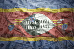 Colorful waving swaziland flag on a  dollar money background Stock Photography