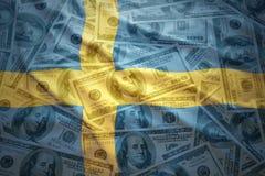 Colorful waving swedish flag on a dollar money background Royalty Free Stock Photo