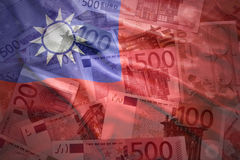 Colorful waving taiwan flag on a euro background. Colorful waving taiwan flag on a euro money background royalty free stock image