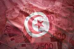 Colorful waving tunisian flag on a euro background. Colorful waving tunisian flag on a euro money background stock photography