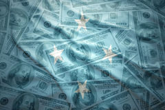 Colorful waving united States of Micronesia flag on a dollar money background Royalty Free Stock Image