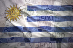 Colorful waving uruguayan flag on a euro  background Royalty Free Stock Photo