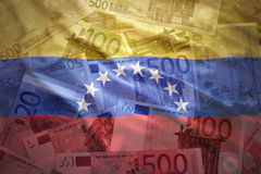 Colorful waving venezuelan flag on a euro  background Royalty Free Stock Images