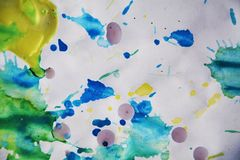 Colorful wax background, paint watercolor and waxy spots Stock Image
