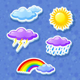 Colorful weather icon set. With clouds, rainbow and sun Royalty Free Stock Photos