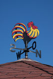 Colorful weather vane. On a roof stock photos