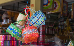 The colorful weave basket hang for sell at the grocery shop Royalty Free Stock Photography