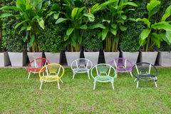 Colorful weave chairs in garden Stock Photography