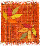 Colorful weave interlace plaid with embroidery of stylized leafs Royalty Free Stock Photography