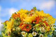 Colorful wedding bouquet. In a blue sky background Royalty Free Stock Photos