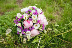 Colorful wedding bouquet on grass Royalty Free Stock Photo
