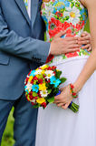 Colorful wedding bouquet in hands of the bride Stock Photography