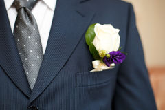 Colorful wedding boutonniere on suit of groom Royalty Free Stock Photo
