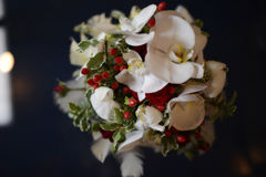 Colorful wedding flower arrangement with large white orchids and red accents. Romantic wedding floral arrangement ready for the bride to be. Wedding florist royalty free stock photo