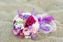 Colorful wedding flowers on the beach. Stock Image
