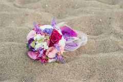 Colorful wedding flowers on the beach. Colorful wedding flowers on the beach, sand surface Stock Photo