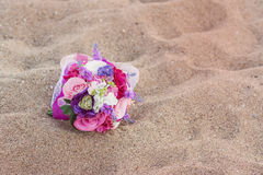 Colorful wedding flowers on the beach. Stock Images