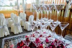Colorful wedding glasses with champagne. Champagne glasses. Wedding slide champagne for bride and groom outdoors. Colorful wedding glasses with champagne Stock Photography