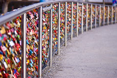 Colorful wedding padlocks, bridge... Good quality photo of a modern steal bridge over some river in Europe, bridge full of wedding locks (thousands of colorful Stock Photography