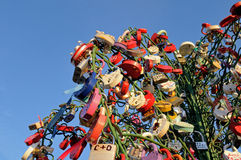 Colorful wedding padlocks on a metal tree against blue sky Royalty Free Stock Photo