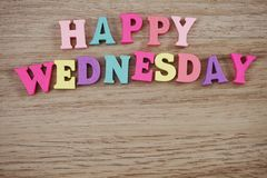 Colorful Happy Wednesday alphabet letters on wooden background. Top view of colorful Happy Wednesday alphabet letters on wooden background stock image