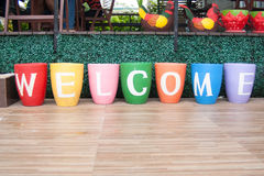 Painted Flower Pots Spell Welcome Stock Photos