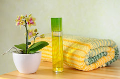Colorful wellness set. Decorative wellness set with orchid, perfume and towel Stock Image