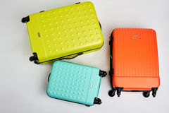 Colorful wheeled suitcases, top view. Stock Photo