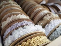 Ribbons. Colorful, white ribbons backgroud, display on shelf, ready to sew stock photo