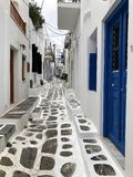 Colorful white streets with blue doors and windows on the island of Mykonos. stock photos