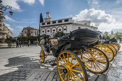 Black buggy and orange carriage wheels in Spain stock photo