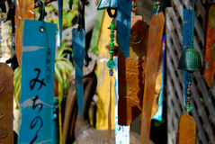 Wind chimes. A collage of bright colors of metal and glass wind chimes catches your eye. Image the soft tinkle sounds as the breeze blows Royalty Free Stock Photo