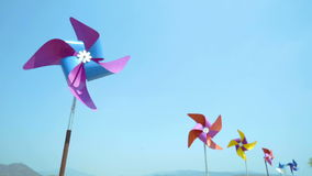 Colorful wind turbine rotating. By blowing of wind