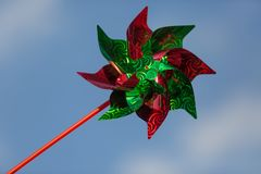 Colorful wind vane with sky as background.  stock photography