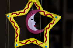 Colorful windbell with moon like face Stock Photos