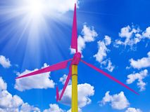 Colorful windmill against a bright sunny sky Stock Images