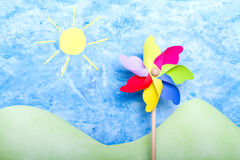 Colorful windmill on handmade environment stock photo