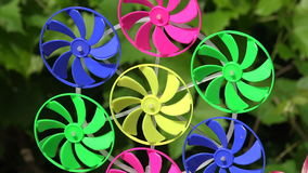 Colorful windmill toy in garden, 4 K stock video
