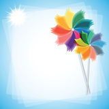 Colorful windmills  on blue-white background. Royalty Free Stock Images