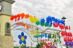 Colorful windmills in Putrajaya Malaysia. Colorful windmills , grouped together in different color, at Putrajaya Malaysia Royalty Free Stock Image