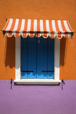Colorful Window with Awning. Colorful window with shutters and awning in Venice, Italy. Vertical shot stock images